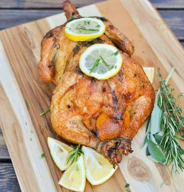 Paleo whole chicken recipe with lemon, garlic, herbs, butter and baked at 425 to perfection