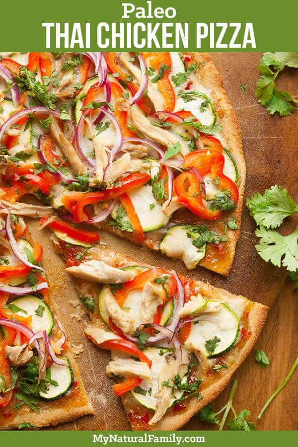 Thai Chicken Paleo Pizza Recipe with Paleo Sweet Chili Sauce. This pizza has a bold flavor and features fresh, crisp vegetables and bright colors. #mynaturalfamily #paleo #paleorecipes #healthyeating #healthyrecipes #healthyfood