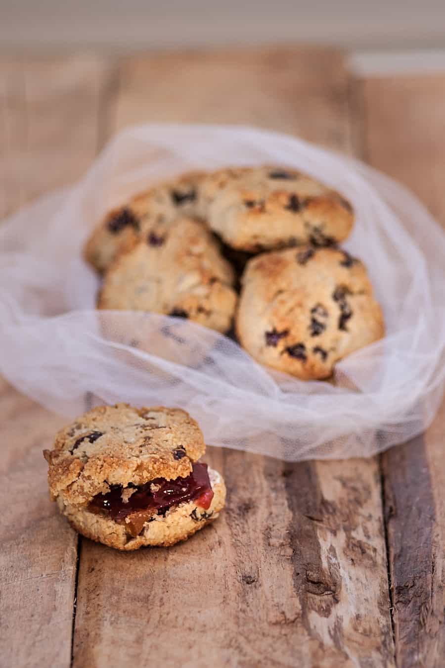 Almond flour scones filled with dried apricots, dried cranberries, sunflower seeds and topped with butter and jelly