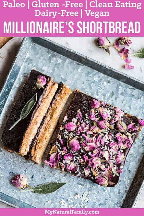 These Paleo millionaire's shortbread bars have a shortbread base, topped with a caramel layer and then a layer of dark chocolate then sprinkled with rosebuds for a special treat! {Paleo Gluten-Free, Clean Eating, Dairy-Free, Vegan} #paleo #paleorecipes #mynaturalfamily
